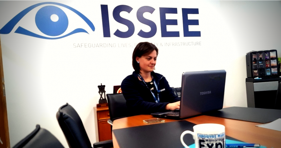 An member of ISSEE office staff working on a laptop